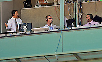 10 June 2012: Washington Nationals broadcasters (left to right) Charlie Slowes, Dave Jageler and F.P. Santangelo, watch from the press box during a game against the Boston Red Sox at Fenway Park in Boston, MA. The Nationals defeated the Red Sox 4-3 to sweep their 3-game interleague series. Mandatory Credit: Ed Wolfstein Photo