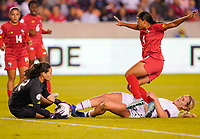 HOUSTON, TX - JANUARY 31: Sasha Jeaneth #12 of Panama and Lindsey Horan #9 of the United States collide during a game between Panama and USWNT at BBVA Stadium on January 31, 2020 in Houston, Texas.