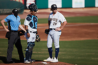 Charleston RiverDogs catcher Michael Berglund (15) checks on starting pitcher Cole Wilcox (25) during the game against the Augusta GreenJackets at Joseph P. Riley, Jr. Park on June 27, 2021 in Charleston, South Carolina. (Brian Westerholt/Four Seam Images)