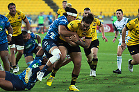 Peter Umaga-Jensen is tackled during the Super Rugby Aotearoa match between the Hurricanes and Blues at Sky Stadium in Wellington, New Zealand on Saturday, 27 February 2021. Photo: Mike Moran / lintottphoto.co.nz