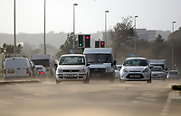 "Pictured: Cars traveling on Oystermouth Road get blasted by sand blown from the beach in Swansea, UK. Monday 16 October 2017<br /> Re: Remnants of Hurricane Ophelia are expected to bring strong gusts of wind to Wales when it hits Britain's shores.<br /> The hurricane, making its way from the Azores in the Atlantic Ocean, will have weakened to a storm when it arrives.<br /> A Met Office amber ""be prepared"" warning has been issued in some areas bringing ""potential danger to life""."