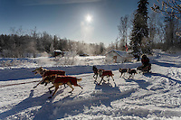 Paul Gebhart runs past the hot springs and steam rising as he leaves the checkpoint in Manley Hot Springs on March 10, 2015.   2015 Iditarod.<br /> <br /> (C) Jeff Schultz/SchultzPhoto.com - ALL RIGHTS RESERVED<br />  DUPLICATION  PROHIBITED  WITHOUT  PERMISSION