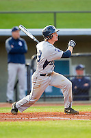 Ben Morgan (18) of the Georgia Southern Eagles follows through on his swing against the UNCG Spartans at UNCG Baseball Stadium on March 29, 2013 in Greensboro, North Carolina.  The Spartans defeated the Eagles 5-4.  (Brian Westerholt/Four Seam Images)