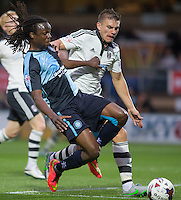 Marcus Bean of Wycombe Wanderers and Shaun Hutchinson of Fulham battle for the ball during the Capital One Cup match between Wycombe Wanderers and Fulham at Adams Park, High Wycombe, England on 11 August 2015. Photo by Andy Rowland.