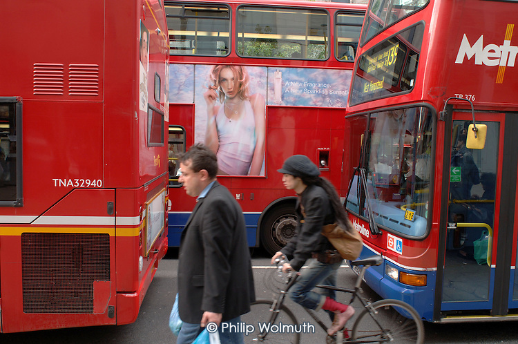 Pedestrian, cyclist and buses in Oxford Street, London.