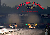 Aug 30, 2014; Clermont, IN, USA; NHRA top fuel driver Leah Pritchett (left) races alongside Cory McClenathan during qualifying for the US Nationals at Lucas Oil Raceway. Mandatory Credit: Mark J. Rebilas-USA TODAY Sports