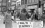 Pittsburgh PA:  View of the annual Pittsburgh Saint Patrick's Day parade on Fifth Avenue.  The view is uptown near the Civic Arena. All the local politicians and judges were actively involved in the festivities.