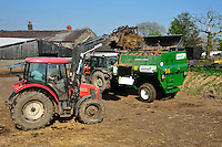 Loading a Keenan feeder wagon with silage, Staffordshire....Copyright..John Eveson, Dinkling Green Farm, Whitewell, Clitheroe, Lancashire. BB7 3BN.01995 61280. 07973 482705.j.r.eveson@btinternet.com.www.johneveson.com