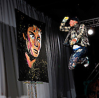 Rhythm and Hue artist/performer/painter David Garibaldi wows the crowds in downtown Charlotte NC during First Night Charlotte 2010. Los Angeles-based Garibaldi creates large-format paintings of pop icons, entertaining crowds with his enthusiastic painting style. The family-friendly public event (no alcohol allowed) is an annual cultural New Year's Eve celebration held in downtown / uptown / Charlotte center city. Charlotte First Night - An Imagination Celebration brought together artists, musicians, dancers and more from across the country. The New Year's event is organized by Charlotte Center City Partners, which facilitates and promotes the economic and cultural development of this North Carolina urban core.