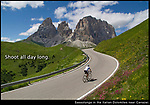 """When traveling, you usually don't have the opportunity to return during better light. Strong lines and color allow you to photograph all day long, not just during the """"golden"""" hours.<br /> Cycling towards Sassolungo in the Dolomite Mountains, northeast Italy."""