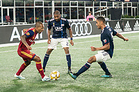 FOXBOROUGH, MA - SEPTEMBER 21: Everton Luiz #25 of Real Salt Lake is double teamed by Andrew Farrell #2 of New England Revolution and Brandon Bye #15 of New England Revolution during a game between Real Salt Lake and New England Revolution at Gillette Stadium on September 21, 2019 in Foxborough, Massachusetts.