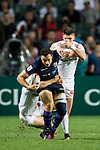 Jamie Farndale of Scotland is tackled by players of England during their Pool C match between England and Scotland as part of the HSBC Hong Kong Rugby Sevens 2018 on 06 April 2018, in Hong Kong, Hong Kong. Photo by Marcio Rodrigo Machado / Power Sport Images
