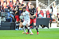 WASHINGTON, DC - NOVEMBER 8: Anthony Jackson-Hamel #11 of Montreal Impact battles for the ball with Frederic Brilliant #13 of D.C. United during a game between Montreal Impact and D.C. United at Audi Field on November 8, 2020 in Washington, DC.