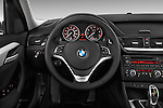 Steering wheel view of a 2013 BMW X1 sDrive28i