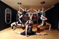 Pictured clockwise from bottom LEFT: Kimberley Jones, Tina Lediard, Laura Fidoe, Sian O'Shea, Reb Wilkshire, organiser Lisa Broughton and Emily Kennedy (FRONT). Saturday 22 February 2014<br /> Re: Eight women have attempted to set a new world record of most people pole dancing at the same time.<br /> Pole 4 Life world record attempt was organised by Lisa Broughton at her Pole Twisters dance studio in Cardiff.<br /> The women had to pole dance for six minutes to set the new record.