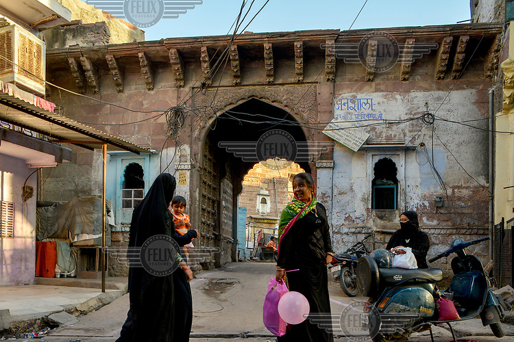 Women in front of an old gateway in a Muslim quarter of Jodhpur's old city.