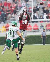The Georgia Bulldogs played North Texas Mean Green at Sanford Stadium.  After North Texas tied the game at 21 early in the second half, the Georgia Bulldogs went on to score 24 unanswered points to win 45-21.  Georgia Bulldogs defensive end Sterling Bailey (58) comes close to blocking the punt of North Texas Mean Green punter Blake Macek (40)