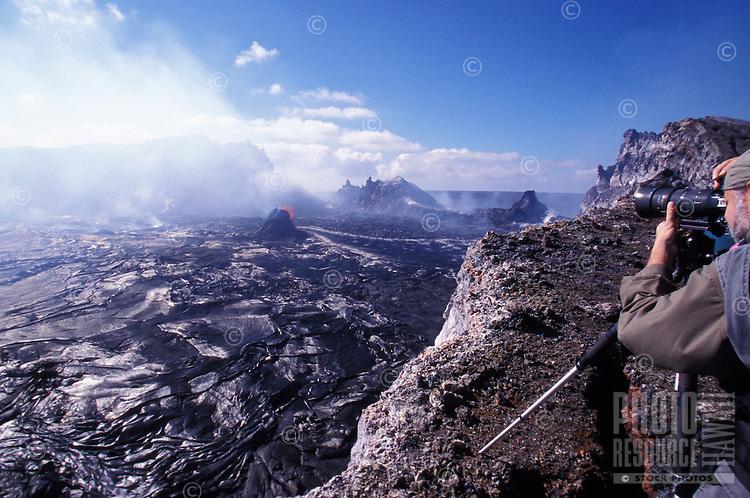 Veteran volcano photographer Brad Lewis filming the eruption of Pu' O'o caldera, Volcanoes National Park