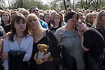 """Jade Goody Funeral April 4 2009. TV Reality Star funeral service at St Johns Chuch Buckhurst Hill Essex England. Well wishers watch funeral service on lage TV screens outside. Message with old Teddy Bear reads """" You will always be missed. Rest in peace from Tracey and Leah""""."""
