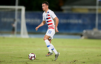 GEORGETOWN, GRAND CAYMAN, CAYMAN ISLANDS - NOVEMBER 19: Daniel Lovitz #5 of the United States moves with the ball looking for an open man during a game between Cuba and USMNT at Truman Bodden Sports Complex on November 19, 2019 in Georgetown, Grand Cayman.