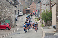 peloton rolling through town<br /> <br /> 85th La Flèche Wallonne 2021 (1.UWT)<br /> 1 day race from Charleroi to the Mur de Huy (BEL): 194km<br /> <br /> ©kramon