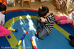 Preschool Headstart 3-5 year olds boy sitting leaning forehead on arm hunched over   emotions sad isolated unhappy horizontal