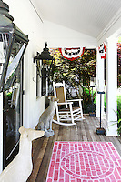 white patio<br /> <br /> Originally a barn in the 1700's it was added on to by different owners until it eventually became a six bedroom New England style white clapboard house located near Southhampton, New York.