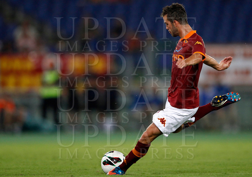 Calcio, Serie A: Roma-Catania. Roma, stadio Olimpico, 26 agosto 2012..AS Roma midfielder Miralem Pjanic, of Bosnia, kicks the ball during the Italian Serie A football match between AS Roma and Catania, at Rome, Olympic stadium, 26 August 2012. .UPDATE IMAGES PRESS/Isabella Bonotto