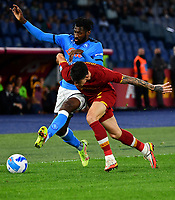 Calcio, Serie A: AS Roma vs SSC Napoli, Olympic stadium, October 24, 2021.<br /> Roma's Roger Ibanez (R) in action with Napoli's Zambo Anguissa (L) during the Italian Serie A football match between Roma and Napoli at Rome's Olympic stadium, on , October 24, 2021. <br /> UPDATE IMAGES PRESS/Isabella Bonotto