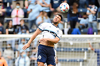 KANSAS CITY, KS - MAY 16: Lucas Cavallini #9 Vancouver Whitecaps heads the ball during a game between Vancouver Whitecaps and Sporting Kansas City at Children's Mercy Park on May 16, 2021 in Kansas City, Kansas.