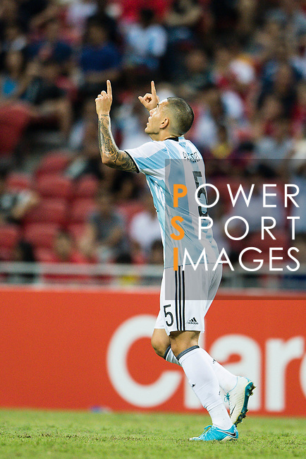 Leandro Paredes of Argentina (R) celebrates his score during the International Test match between Argentina and Singapore at National Stadium on June 13, 2017 in Singapore. Photo by Marcio Rodrigo Machado / Power Sport Images