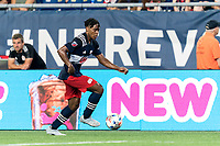 FOXBOROUGH, MA - JULY 7: DeJuan Jones #24 of New England Revolution brings the ball forward during a game between Toronto FC and New England Revolution at Gillette Stadium on July 7, 2021 in Foxborough, Massachusetts.