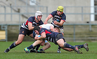 Wednesday 6th March 2019   Ulster Schools Cup - Semi Final 2<br /> <br /> Ben Gourley is tacked by Harry Long, Ben Carson and Reuben Crothers during the Ulster Schools Cup semi-final between MCB and Wallace High School at Kingspan Stadium, Ravenhill Park, Belfast, Northern Ireland. Photo by John Dickson / DICKSONDIGITAL