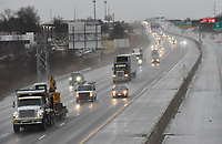 HEADLIGHTS ON<br />Vehicles with headlights on move Wednesday Jan. 6 2021 along Interestate 49 in Rogers during a foggy, drizzly morning. State law requires that motorists turn on headlights when windshield wipers are in use. Go to nwaonline.com/210107Daily/ to see more photos.<br />(NWA Democrat-Gazette/Flip Putthoff)