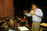 Uri Segal conductor  conducting a rehearsal of the Royal Philharmonic Orchestra at the  Barbican London 1990s UK