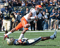 Virginia safety Anthony Harris (8) misses an interception intended for Pitt wide receiver Tyler Boyd (23).The Pitt Panthers defeated the Virginia Cavaliers 14-3 at Heinz Field, Pittsburgh, PA on Saturday, September 28, 2013.