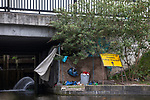 © Joel Goodman - 07973 332324 . 30/04/2017 . Salford, UK . Homeless men are living in a towpath tunnel in Saford , in the shadow of the Ordsall Chord railway link and a large , Chinese-backed housing development. Photo credit : Joel Goodman