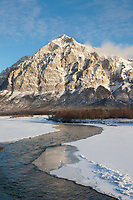 Winter landscape of the Koyukuk River at freeze up and Mt Dillon of the Brooks Range in the distance.