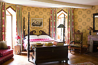 Situated in one of the towers this bedroom is designed in the Empire style