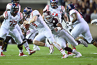 Ole Miss quarterback Bo Wallace (14) is brought down by Texas A&M defensive lineman Myles Garrett (15) during first half of an NCAA football game, Saturday, October 11, 2014 in College Station, Tex. Ole Miss leads Texas A&M 21-0 at the halftime. (Mo Khursheed/TFV Media via AP Images)