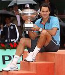 June 7, 2009.Roger Federer of Switzerland displays trophy after defeating Robin Soderling of Sweeden in the final of the French Open, at Roland Garros, Paris