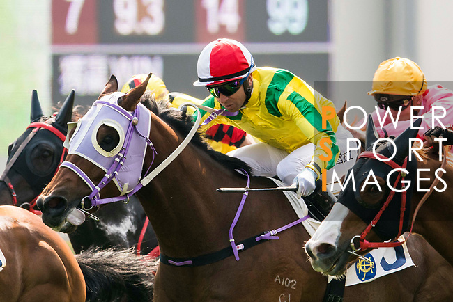 Jockey Joao Moreira riding Bravo Watchman #3 competes in the Race 2, Able Friend Handicap, during the Longines Hong Kong International Races at Sha Tin Racecourse on December 10 2017, in Hong Kong, Hong Kong. Photo by Victor Fraile / Power Sport Images