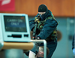An attacker threatens passengers during a bilateral training exercise between An Garda Siochana and the Defence Forces hosted at Shannon Airport. Photograph by John Kelly.