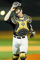 Catcher Jack Carey #20 of the Wake Forest Demon Deacons on defense against the Miami Hurricanes at Gene Hooks Field on March 18, 2011 in Winston-Salem, North Carolina.  Photo by Brian Westerholt / Four Seam Images