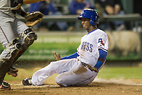 Round Rock second baseman Jurickson Profar (10) slides home in the Pacific Coast League baseball game against the Nashville Sounds on May 4, 2013 at the Dell Diamond in Round Rock, Texas. Round Rock defeated Nashville -6. (Andrew Woolley/Four Seam Images).