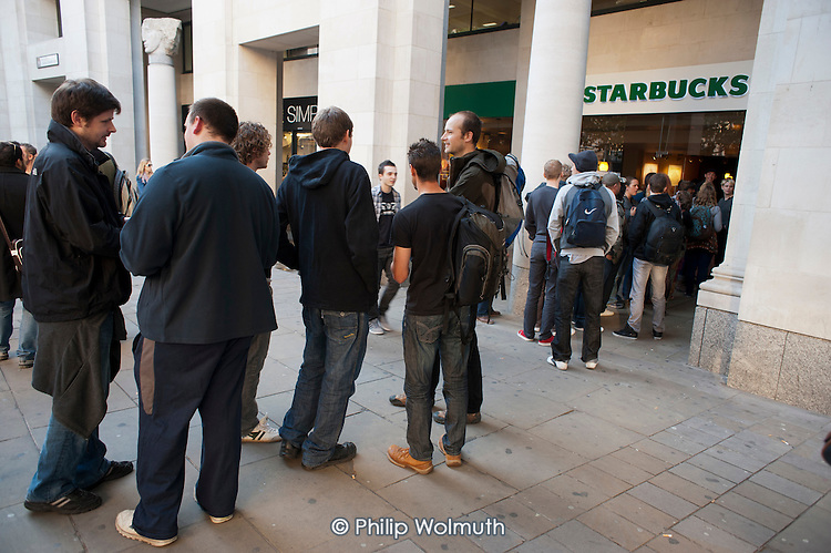 Starbucks toilet queue. Occupy the London Stock Exchange. Protesters gather at St.Pauls Cathedral on a global day of action against corporate greed.