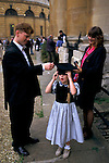 'OXFORD UNIVERSITY' 1995, MATRICULATION STUDENT WITH HIS YOUNG SISTER WHO TRIES ON HIS MORTAR BOARD, 1995