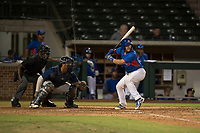 AZL Cubs catcher Henderson Perez (8), at bat in front of home plate umpire Demetrius Hicks and AZL Brewers catcher Caleb Marquez (57), during an Arizona League game against the AZL Brewers at Sloan Park on June 29, 2018 in Mesa, Arizona. The AZL Cubs 1 defeated the AZL Brewers 7-1. (Zachary Lucy/Four Seam Images)