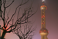 CHINA. Shanghai. A view of the Oriental Pearl Tower. The Oriental Pearl Tower stands by the bank of Huangpu River. It is in the centre of Lujiazui, opposite to the Bund which is famous for its grand buildings of various architectural styles. The tower is 468 metres high. It is the highest TV Tower in Asia and is the third highest one in the world. 2008.