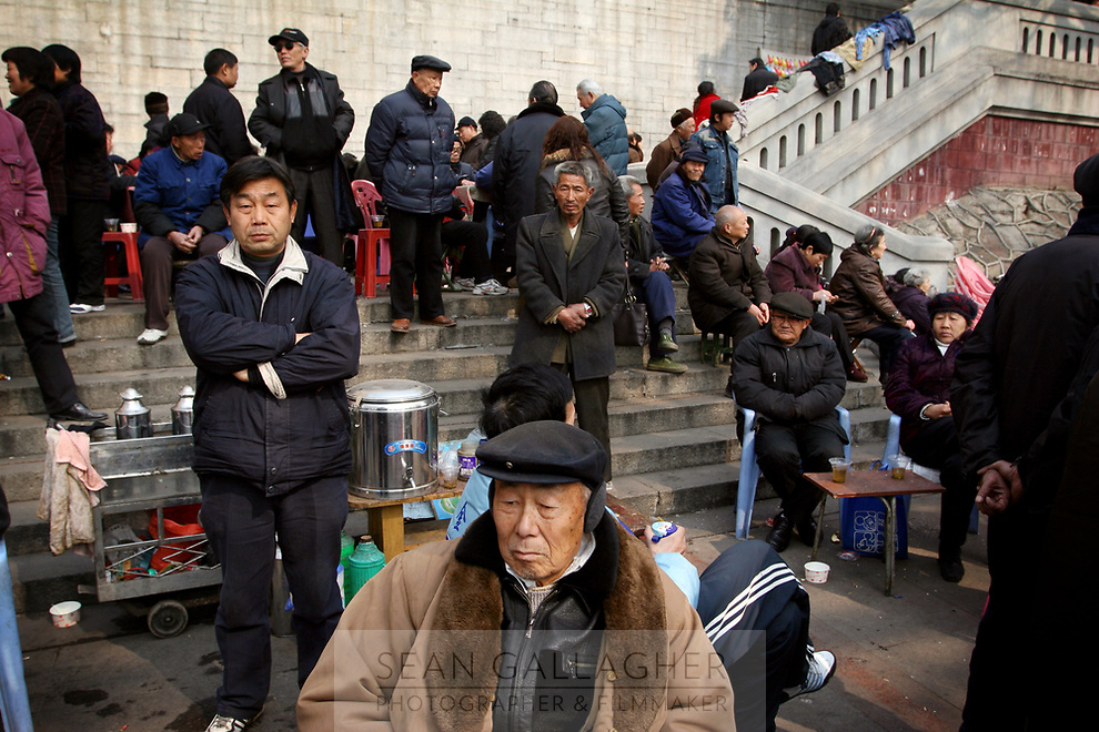 CHINA. Hubei Province. Wuhan. Elderly people gather for morning activites. Wuhan (population 4.3 million) is a sprawling city that sits on both sides of the Yangtze River.  2008
